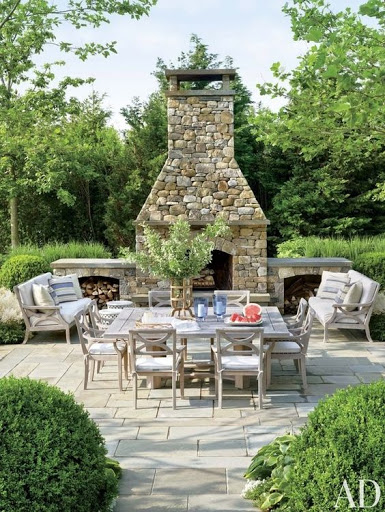 Stone patio with outdoor dining set and fireplace