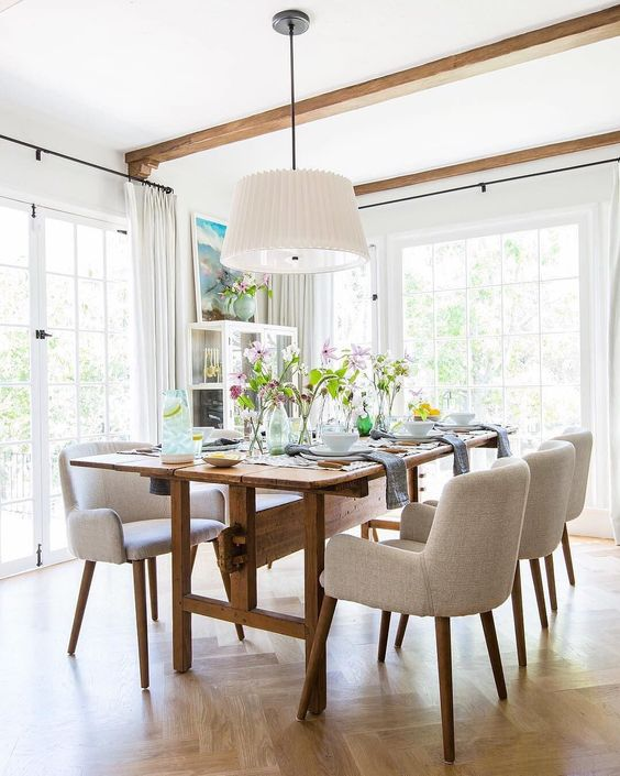 Dining room with proportional light fixture