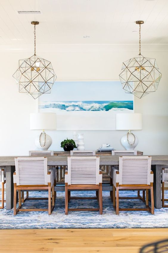 Geometric gold lighting hanging over dining table