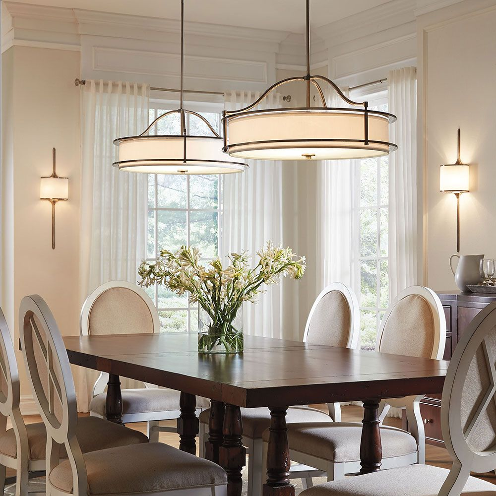 Circular lighting hanging over dining table