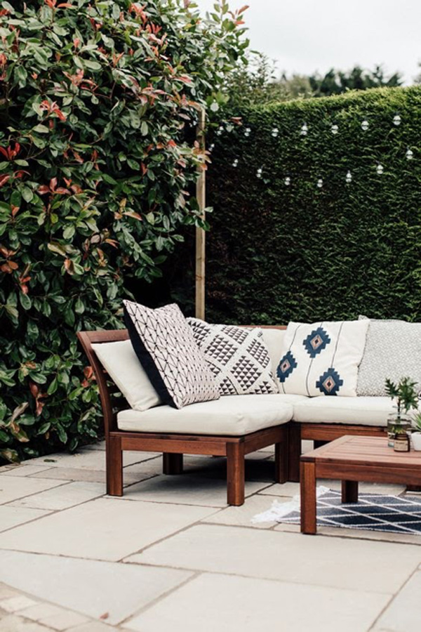 how to refresh your spring patio - outdoor seating and hanging lights