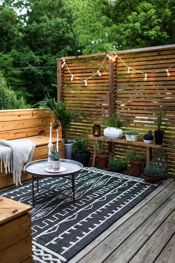 how to refresh your spring patio - outdoor furniture and hanging lights