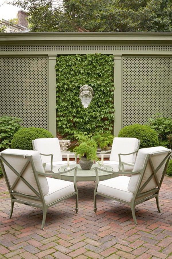 small garden patio with outdoor seating and table