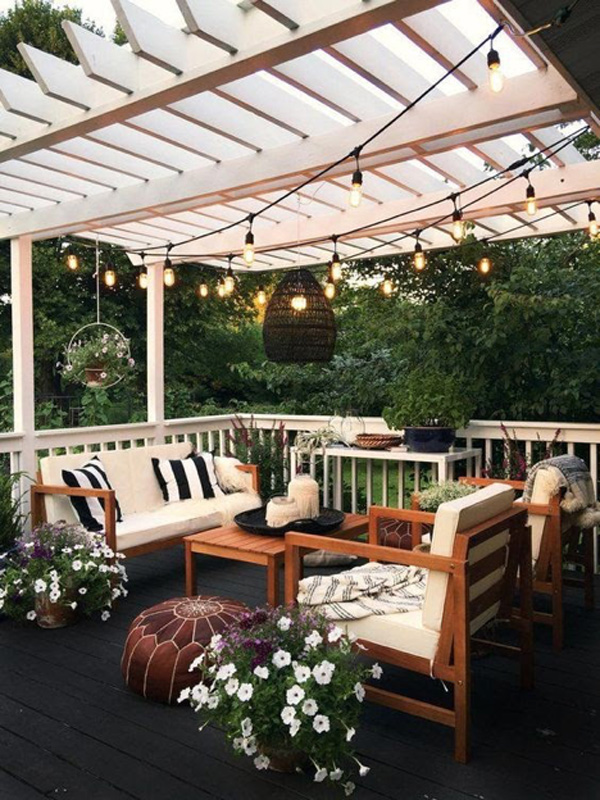 Small outdoor porch with patio furniture and hanging lights