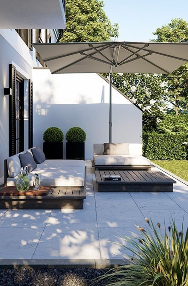 Small outdoor living area with umbrella and patio furniture