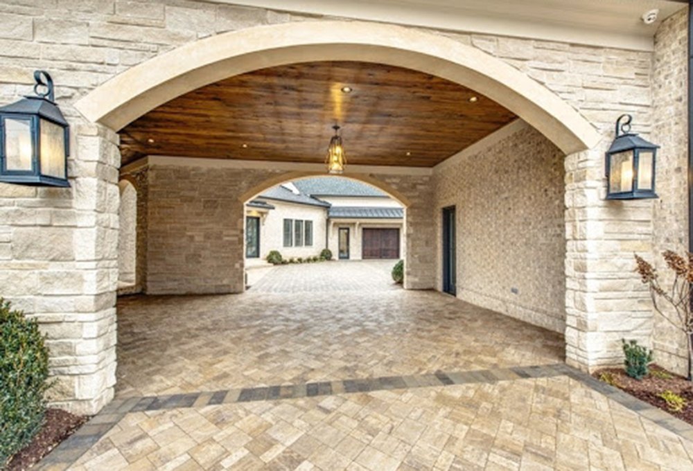 Custom lights lining the entryway of a stone garage